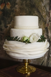 Fondant ruffles, pearls & lace wedding cake